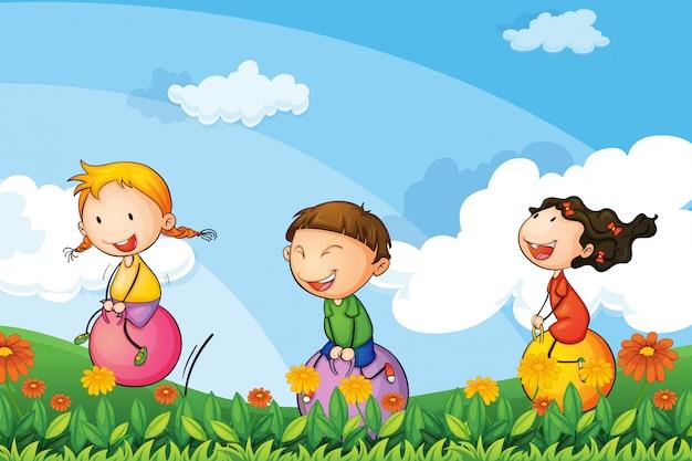 弾む風船で遊ぶ子供たち