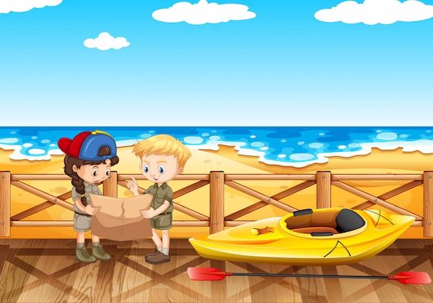 地図を読んで二人の子供と海のシーン
