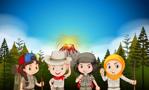 Дети в походной одежде у вулкана