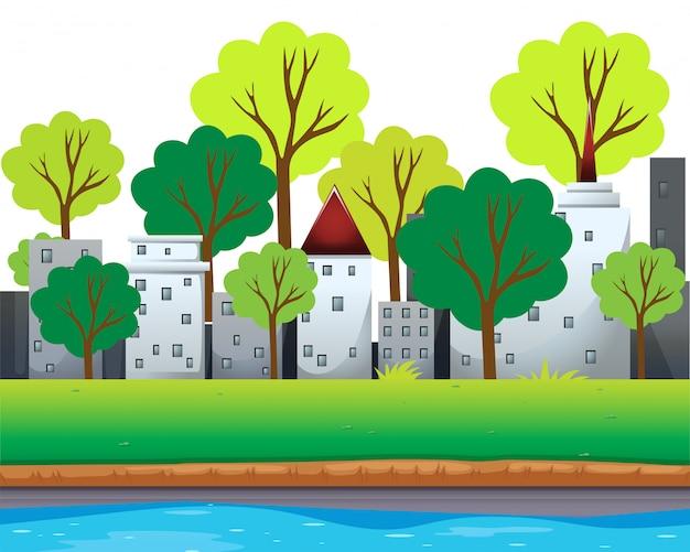 都市の建物と川沿いの木々