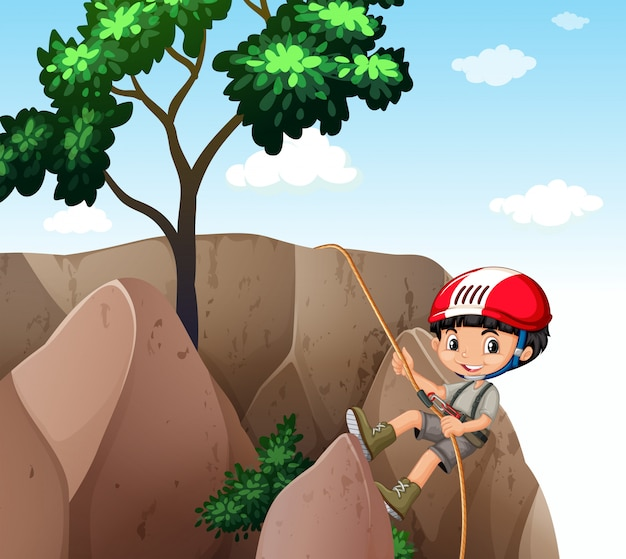 Мальчик, поднимаясь на скалу