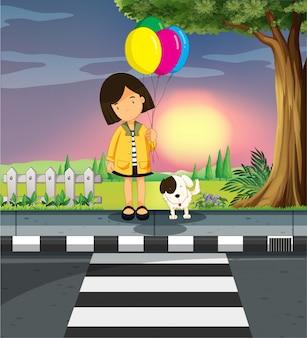 少女と犬が道路を横断