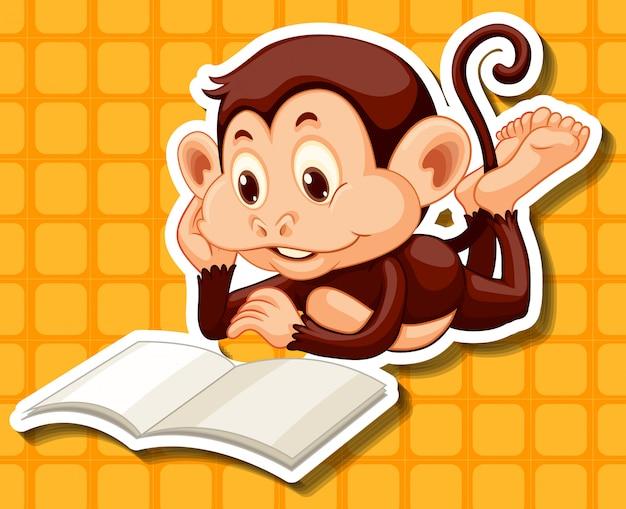 本を読んで小さな猿