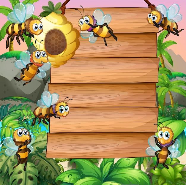 庭を飛んでいる蜂と木の看板