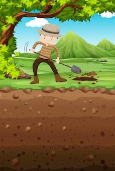 Мужчина роет яму в парке