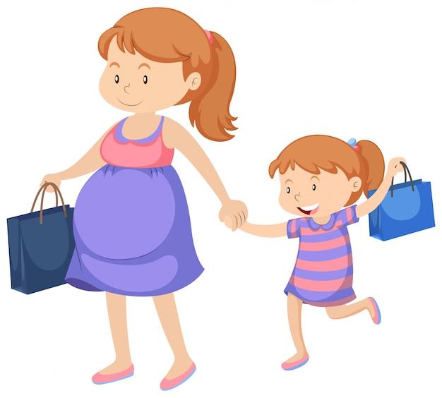 Беременная женщина и маленькая девочка с покупками