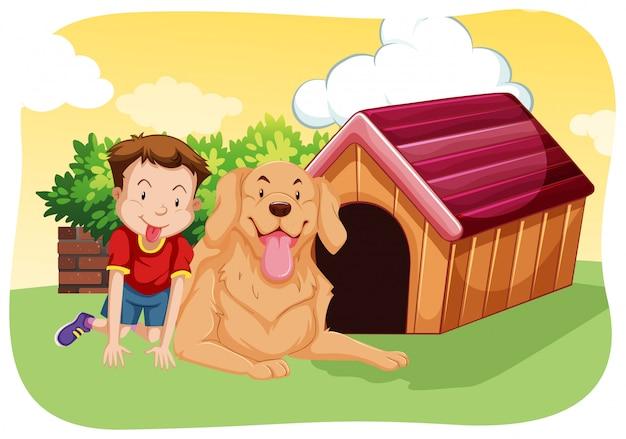 少年と犬、草の上