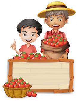 トマトの木製バナーを持つ農家