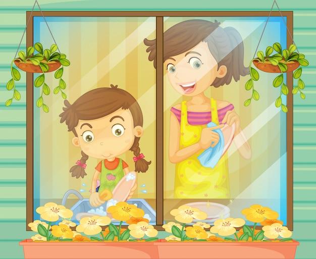 お皿を洗う彼女の母親を助ける子供