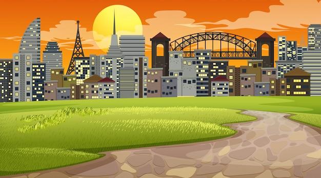 都市公園の夕日のシーンや背景