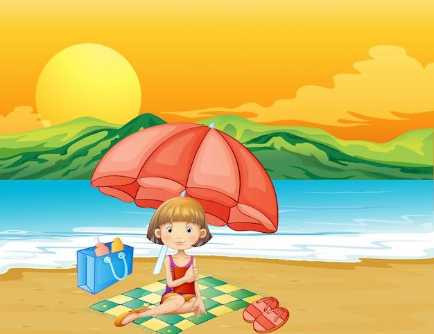 ビーチで本を持つ少女