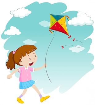 Маленькая девочка играет воздушный змей