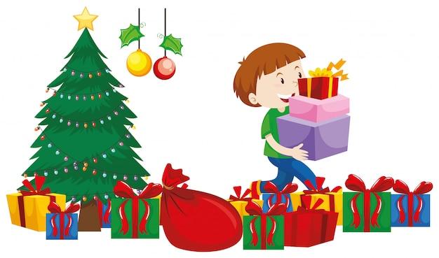 Мальчик с подарочными коробками под елкой