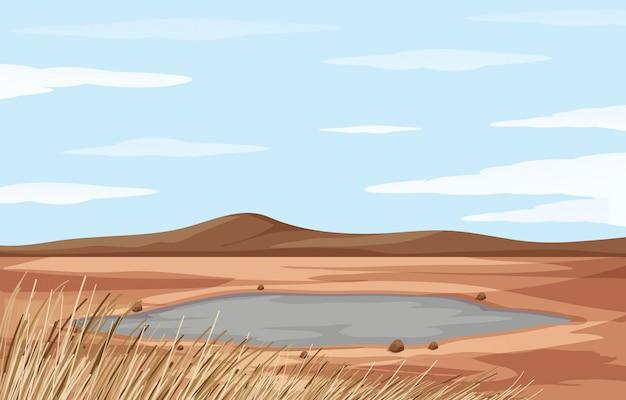 池と乾燥した土地のある風景