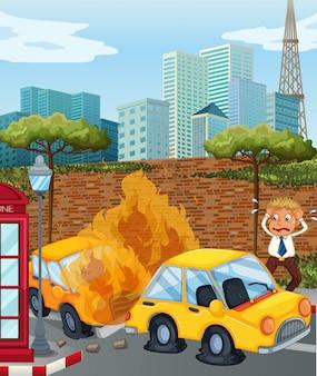 市内で車が燃えている事故シーン