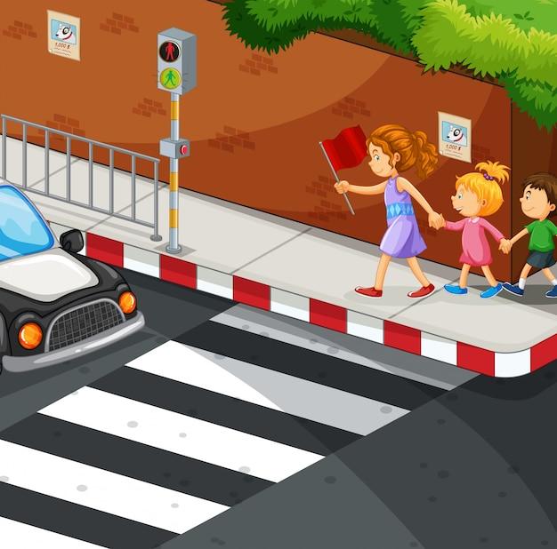 舗装の上を歩く子供たち