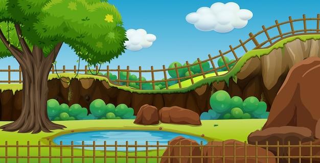 Сцена парка с прудом и забором