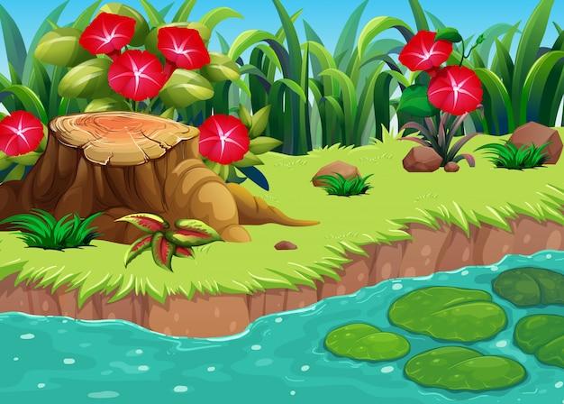 川沿いの赤い花を持つ自然シーン