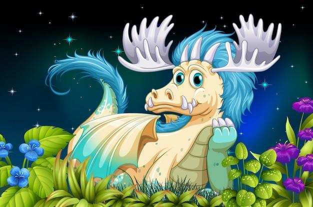 夜の時間に草の上に座っているドラゴン