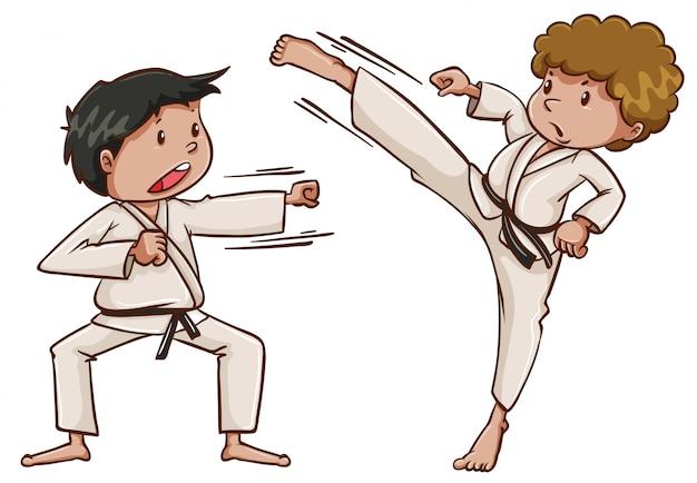Двое детей играют в каратэ
