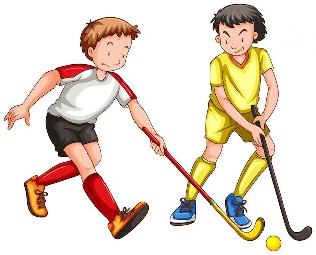 Двое мужчин играют в хоккей на траве