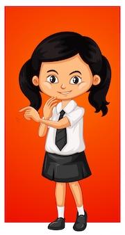 学校の制服を着た幸せな女の子