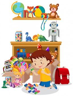 Комната с мальчиком, играющим в игрушки на полу