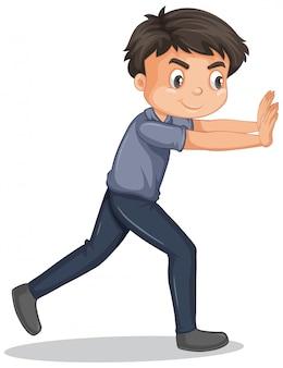 Мальчик в серой рубашке толкает стену