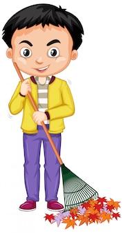 Мальчик сгребает листья с граблями на белом