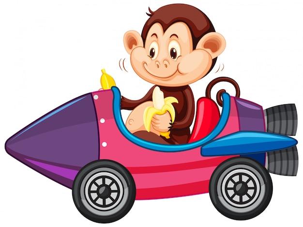 おもちゃのロケットカートに乗った猿