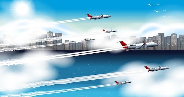 空を飛んでいる多くの飛行機