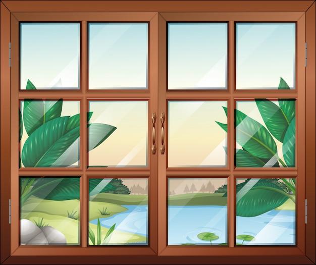 Закрытое окно с видом на пруд