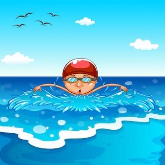 Мальчик купается в море