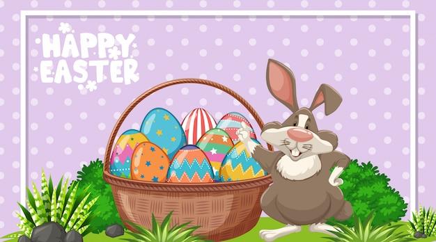 Открытка на пасху с пасхальным кроликом и крашеными яйцами в саду