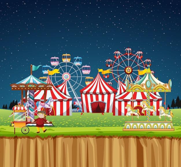 Цирковая сцена с множеством аттракционов в ночное время