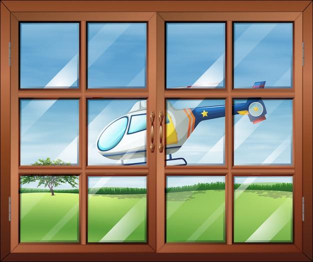 Закрытое окно и вертолет снаружи