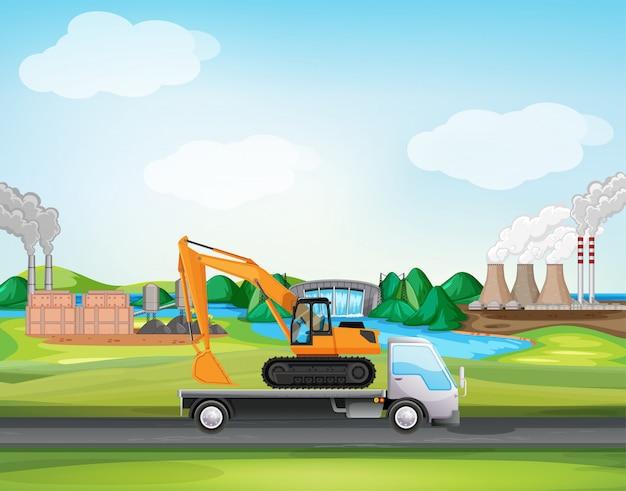 工業地帯を走るトラックのシーン