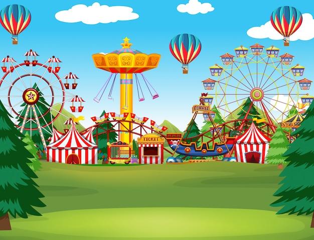 空にたくさんの乗り物と風船があるテーマパークのシーン