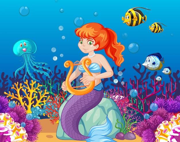 海の動物と海の背景に人魚の漫画のキャラクターのセット