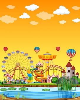 空白の黄色の空と昼間の沼のシーンと遊園地
