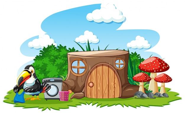白い背景の上のかわいい鳥の漫画のスタイルの切り株の家