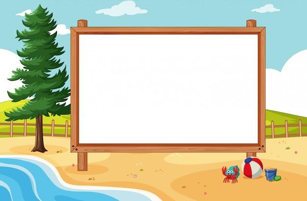 ビーチのシーンで空白の木製フレーム