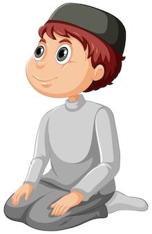 白い背景に分離された伝統的な服でアラブのイスラム教徒の少年