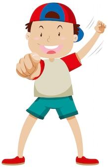 孤立した立っている位置で肯定的な気分で人差し指を指している少年