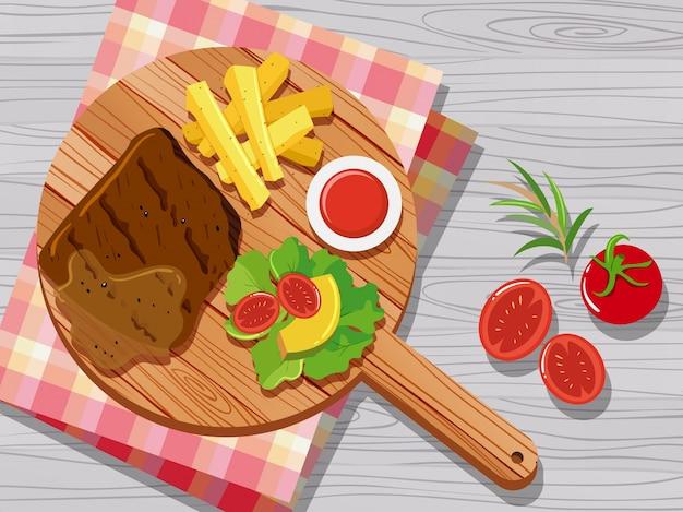 ステーキ、野菜、カッティングボード