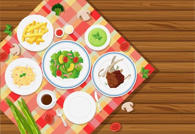 テーブルクロスで食べ物を持つ背景テンプレート