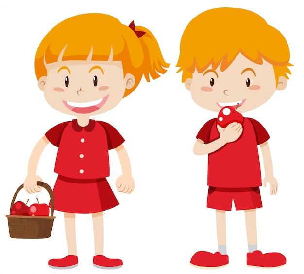 Мальчик и девочка в красном едят яблоки