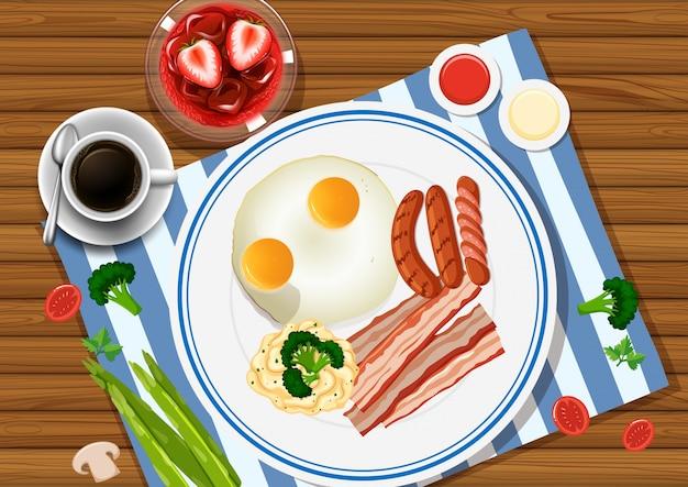 卵とベーコンを片手に食べる