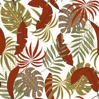 Тренд тропический бесшовный узор с разноцветными листьями и растениями