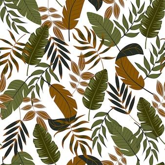 白い背景の上の熱帯の葉と植物のシームレスパターン